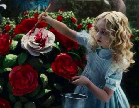 Young Alice in Wonderland painting roses red quote via www