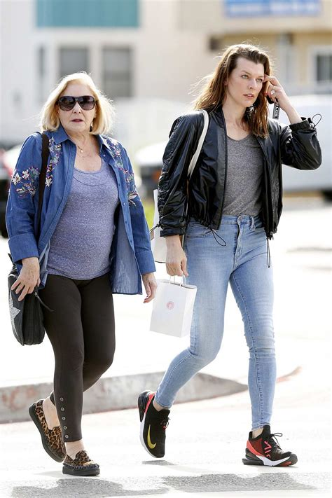 milla jovovich steps out in jeans and leather jacket